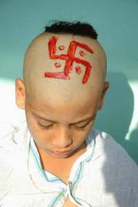 hindu-child-with-head-shaven-has-swastik-made